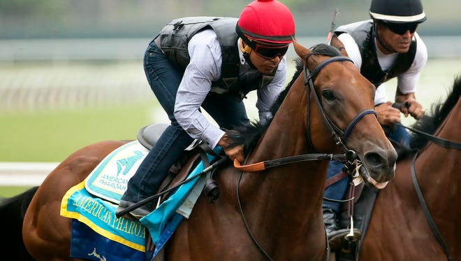 Triple Crown winner American Pharoah and jockey Martin Garcia appear during a workout, Sunday Aug. 23, 2015 at Del Mar Thoroughbred Club in Del Mar, Calif. American Pharoah will run next in the Travers Stakes at a sold-out Saratoga Race Course on Saturday. (Benoit Photo via AP)