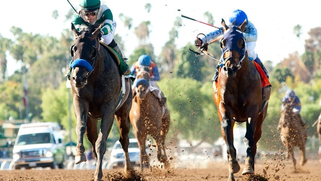 Mor Spirit and jockey Gary Stevens, left, cruise by Uncle Lino (Fernando Perez) to win the Grade II $150,000 Robert B. Lewis Stakes Saturday, February 6, 2016 at Santa Anita Park,