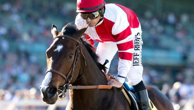 Fox Hill Farms' Songbird and jockey Mike Smith win the Grade II, $300,000 Las Virgenes Stakes, Saturday, February 6, 2016 at Santa Anita Park, Arcadia Calif.