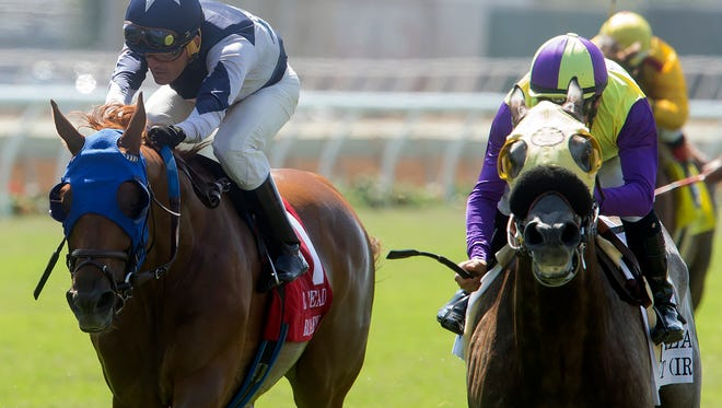 Hunt, with jockey Flavien Prat up, right, outlegs Mr. Roary, with Santiago Gonzalez aboard, to win the $250,000 Eddie Read Stakes on Saturday at Del Mar Thoroughbred Club.