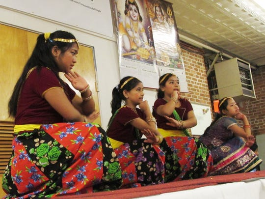 A group of Nepali girls perform a combination of traditional