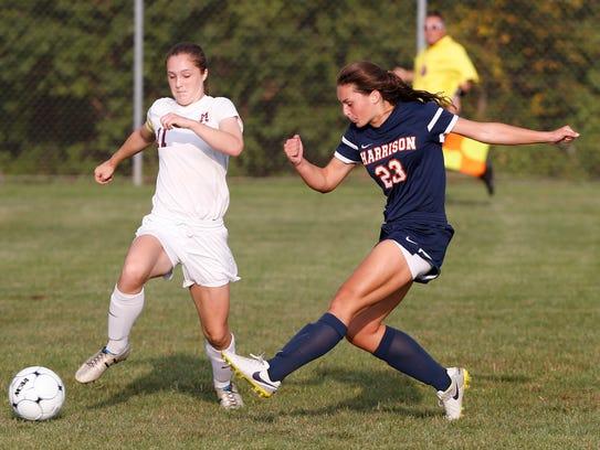 Harrison's Olivia Geswein blasts a shot past Megan