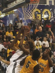Lehigh'sTrevor Scudder fights for a rebound against during the FHSAA 7A Region 3 Championship Friday night at the Lehigh gym.