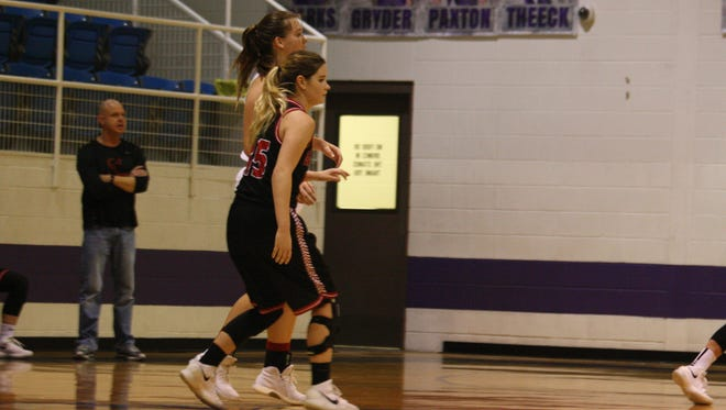 Garden City's Payton Hastings (15) guards Rocksprings' Zoe Burleson as the Lady Angoras try to drive the ball up court against the Lady Bearkat press during a Class 1A girls warmup game Friday, Feb. 9, 2018, at Irion County's Estes Gym in Mertzon.