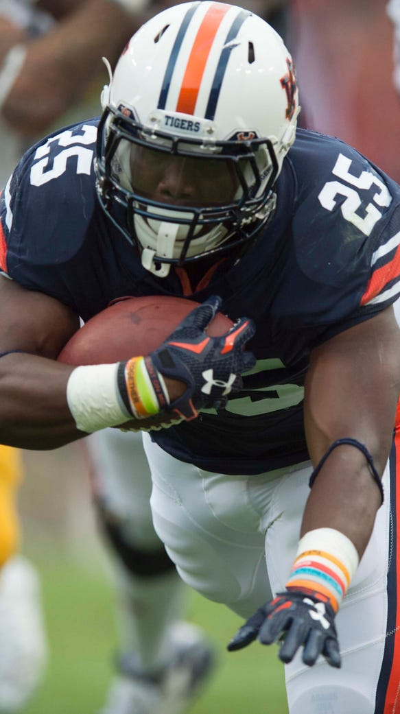 Auburn running back Peyton Barber (25) dives over San