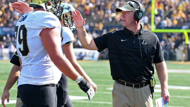 Sep 16, 2017; Columbia, MO, USA; Purdue Boilermakers head coach Jeff Brohm talks with players in the first half of the game against the Missouri Tigers at Faurot Field. Mandatory Credit: Jay Biggerstaff-USA TODAY Sports
