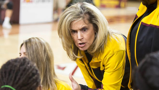 ASU women's head coach Charli Turner Thorne talks with the Gold team in the huddle during the Maroon and Gold Scrimmage in Wells Fargo Arena on Friday, November 7th, 2014 in Tempe.
