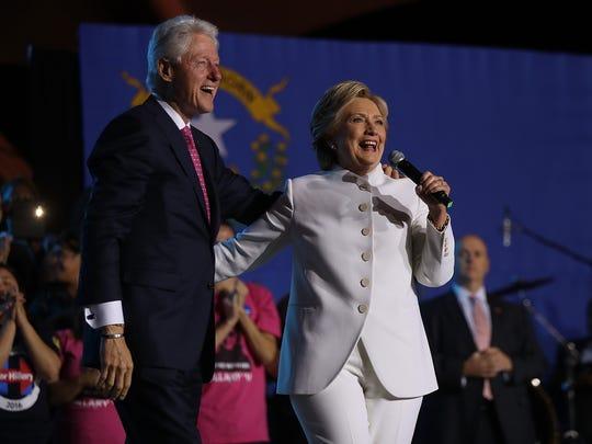Democratic presidential nominee Hillary Clinton (L)