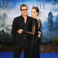 """(FILE PHOTO) Angelina Jolie And Brad Pitt Reported To Have Married At The Weekend In France LONDON, ENGLAND - MAY 08:  Brad Pitt and Angelina Jolie attend a private reception as costumes and props from Disney's """"Maleficent"""" are exhibited in support of Great Ormond Street Hospital at Kensington Palace on May 8, 2014 in London, England.  (Photo by Eamonn M. McCormack/Getty Images) ORG XMIT: 459770435 ORIG FILE ID: 488778057"""