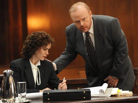 Sarah Paulson and Christian Clemenson play prosecutors