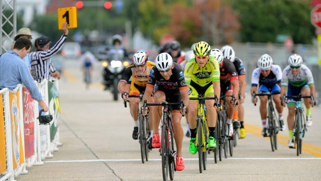 Racers make their way around the Criterium course during the Mens 50+ race last year at the Subway Pensacola Cycling Classic in downtown Pensacola. The event is now part of the USA Cycling national calendar.