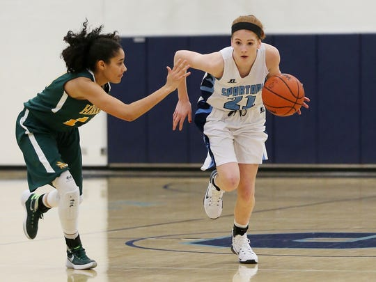 Livonia Stevenson's Grace Lamerson goes on the dribble drive around Harrison's Nyla Warren during Friday night's game.