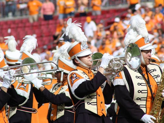 Emma Kate Chambless, center, plays the mellophone, similar to the French horn, in the University of Tennessee's marching band, the Pride of the Southland.