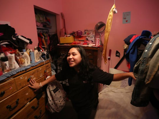Mariana, 12, shows off her completely pink bedroom at the family home in Quincy on Thursday, Feb. 15, 2018. Mariana, Gladis' daughter, was born here in the United States and is a citizen, unlike her mother who faces potential deportation in 2019.