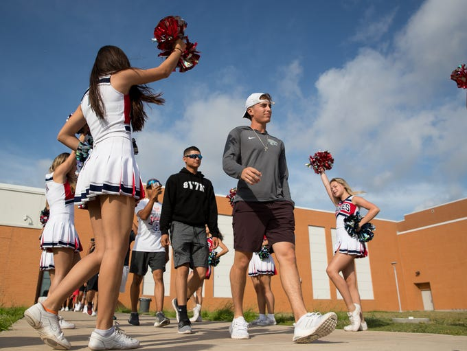 Cheerleaders help send off the Veterans Memorial High