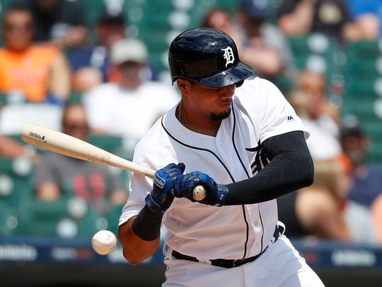 Detroit Tigers' Jeimer Candelario is hit by a Los Angeles Angels' Andrew Heaney pitch in the fourth inning on Thursday, May 31, 2018, at Comerica Park.