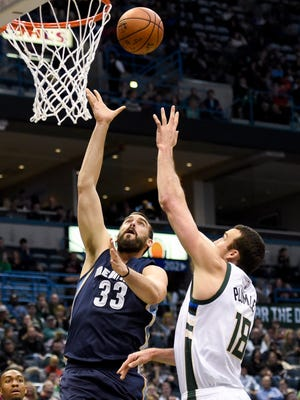 Memphis Grizzlies center Marc Gasol (33) takes a shot against Milwaukee Bucks center Miles Plumlee (18) in the BMO Harris Bradley Center Saturday. Gasol scored 18 points before fouling out.