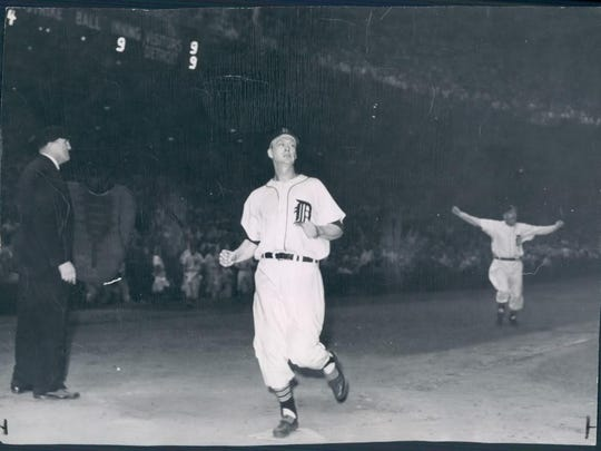 Hoot Evers crossing home plate with his inside the park home run to win the game.