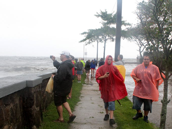 On lookers capture stills and video as Hurricane Irene pounds the Oakland Beach shoreline in Rye Aug. 28, 2011. ( Matthew Brown / The Journal News )