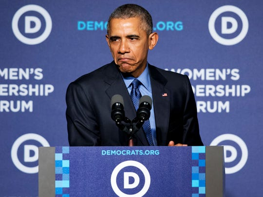 """President Barack Obama makes a """"grumpy cat"""" face as he compared Republicans to the sad Internet cat while speaking to the Democratic National Committee 22nd Annual Women's Leadership Forum National Issues Conference in Washington, Friday, Oct. 23, 2015."""