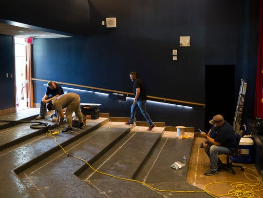 Workers begin to install new seating at the G&L Theater,