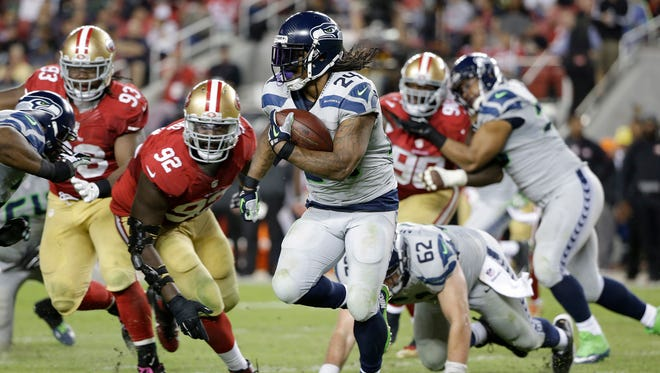 Seattle Seahawks running back Marshawn Lynch (24) runs against San Francisco 49ers defensive end Quinton Dial (92) during the second half of an NFL football game in Santa Clara, Calif. Marshawn Lynch has rejoined the Seattle Seahawks just in time for the playoffs. Coach Pete Carroll said on his radio show Monday morning, Jan. 4, 2016,  that Lynch was back at the team's facility after missing the final seven games of the regular season and undergoing abdominal surgery.
