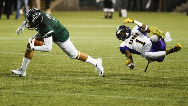 Portland State quarterback Paris Penn (2) avoids the tackle of Northern Iowa defensive back Deiondre' Hall (1) during the first half of a second-round NCAA FCS playoff game at Providence Park on Saturday, Dec. 5, 2015, in Portland, Ore.