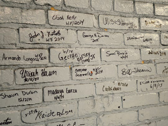 Students who start training at Wreckers Boxing Club write their name and the date on the wall.