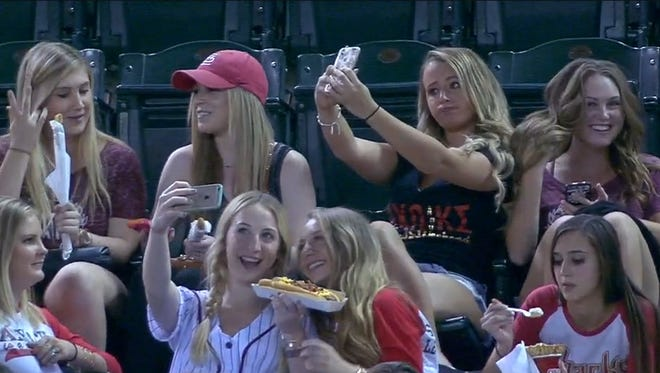 This group of girls took selfies instead of watching baseball.