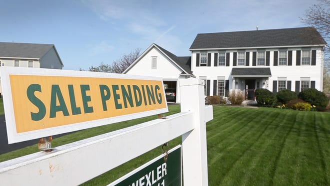"""Bill and Kathy Blackmon house is """"sale pending"""" as they prepare to move from their home in Webster Saturday, May 5, 2018.  The Blackmon's are downsizing and moving to a smaller house in the city of Rochester."""