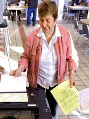 Angela Lopez casts her ballot during the New Mexico