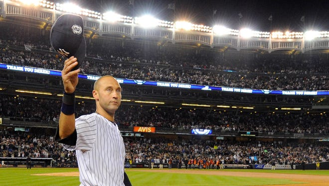 Yankees shortstop Derek Jeter (2) celebrates after a walk-off single in the ninth inning of the game against the Baltimore Orioles at Yankee Stadium. Mandatory Credit: