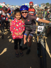 Kaysee Armstrong poses with an Indian girl at the Uttarakhand Himalayan Challenge.