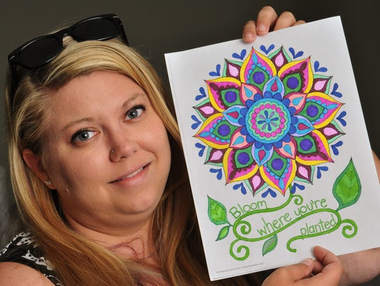 Cassandra Waudby, 27, displays her just-finished coloring