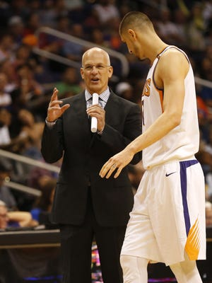 Phoenix Suns interim head coach Jay Triano talks with Phoenix Suns center Alex Len (21) during the third quarter against the Sacramento Kings at Talking Stick Resort Arena October 23, 2017.
