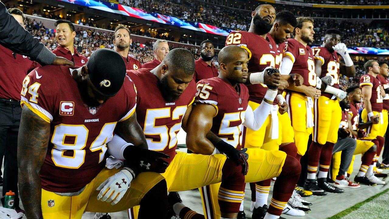 Image result for NFL players kneeling