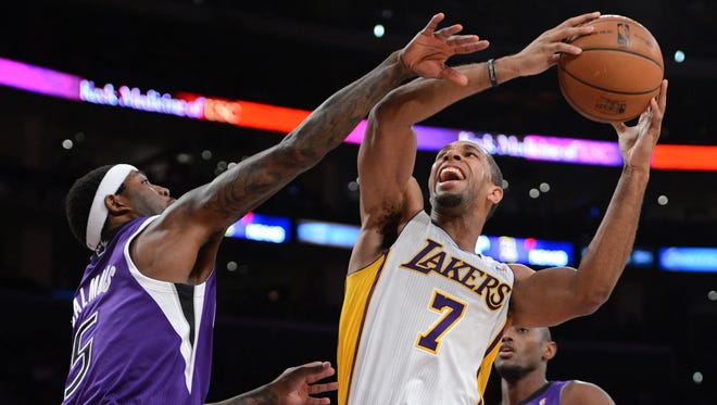 Sacramento Kings small forward John Salmons fouls Los Angeles Lakers small forward Xavier Henry in the first half of the game at Staples Center.