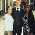 The Youth Advisory Board chose its officers for the new year. From left: Michelle Wills; Daniel Yates; Cleashae Crowder.