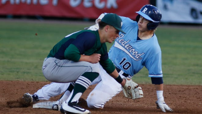 Redwood's Hunter Bryan slides safe into second base Thursday night during a West Yosemite League game at Visalia Rawhide's Recreation Park. El Diamante defeated Redwood 6-2