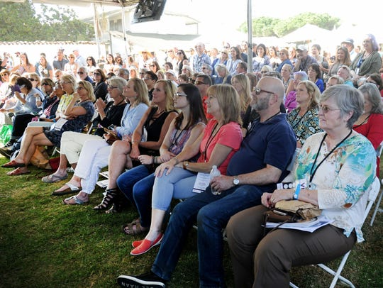 A crowd watches  Martha Stewart cook on Sunday at the