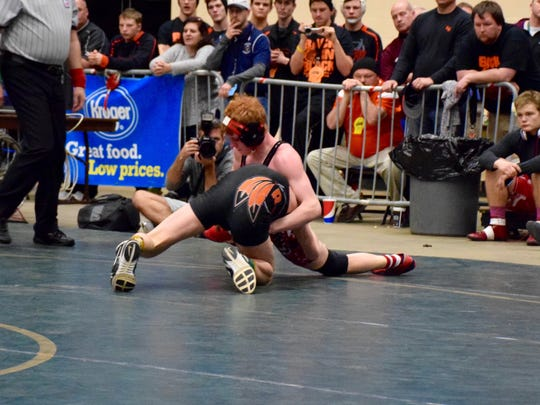 Riverheads' Hunter Sams, top, sprawls to counter a shot by Rural Retreat's Josh Wynn during their 120-pound final Saturday at the Group 1A wrestling championships at the Salem Civic Center. Sams placed second.