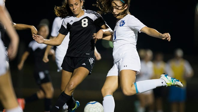 Barron Collier's Sierra Rincon (11) fires a shot in the first half of action at Barron Collier High School Thursday, Jan. 26, 2017 in Naples.