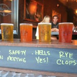 Beer samplers at Ale Mary's Beer Hall in Royal Oak are served in a wooden holder with the beers' names written on a chalkboard side panel, so guests don't have to remember which is which.