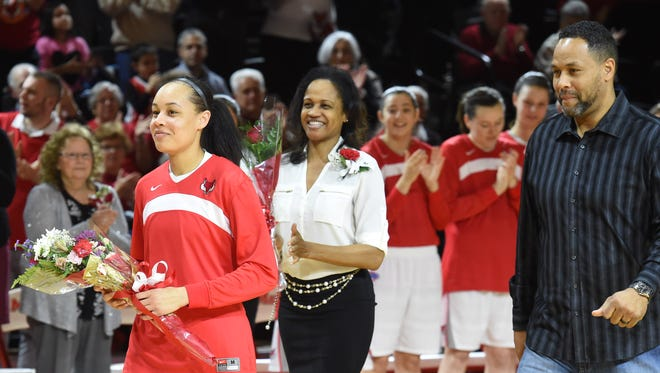 Marist's Sydney Coffey walks ahead of her parents, from left, Sheba and Richard during Senior Night prior to Saturday's game at Marist.