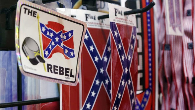Confederate flag-themed stickers are displayed at Arkansas Flag and Banner in Little Rock, Ark. Major retailers including Amazon, Sears, eBay and Etsy and Walmart, are halting sales of the Confederate flag and related merchandise.
