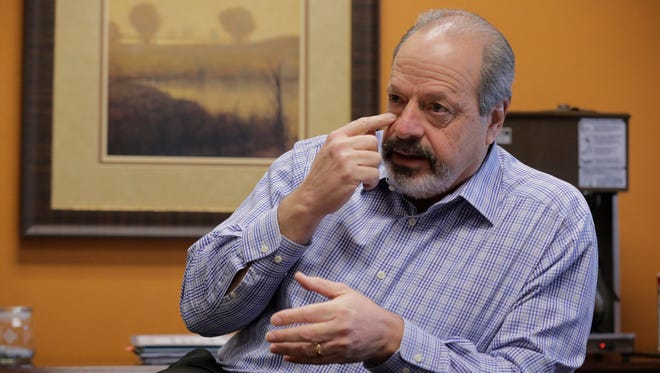 El Paso Mayor Oscar Leeser in a file photo points to the spot on his face were he had a skin spot removed at his wife's insistence. Further examination found that Leeser had skin cancer on the top of his head. Leeser then traveled to the University of Texas MD Anderson Cancer Center in Houston and had the cancer removed. Leeser said Thursday he will not seek re-election.