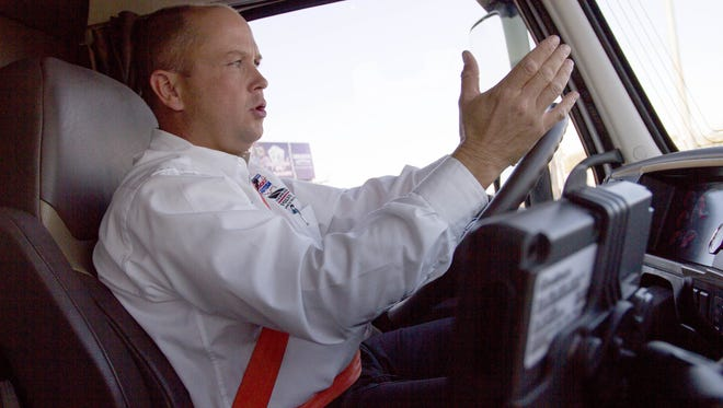 Eric Ramsdell, a professional driver for American Trucking Associations, offers safe driving tips from the driver's seat of a big rig on Jan. 25, 2016, in Phoenix, Ariz.