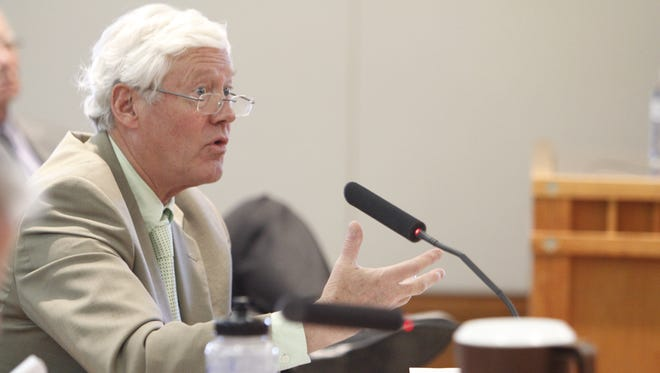 David Abbey, legislative finance committee director, speaks to the Legislative Finance Committee on  Wednesday about the state's new revenue outlook. Declining oil and gas revenues are having a negative effect on the state budget as the session nears its halfway point.