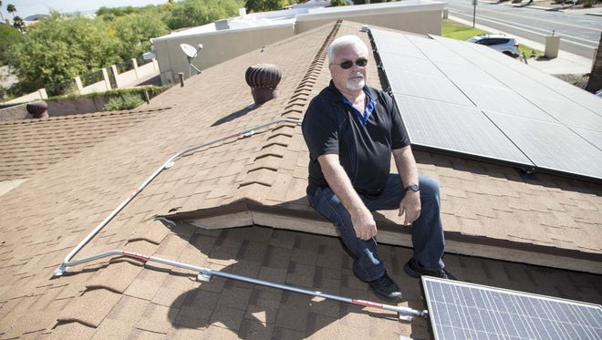 Mike Gattorna had solar installed on his home, but has to wait several weeks for Arizona Public Service Co. before he can turn the system on and begin generating his own electricity. A new voter initiative seeks to end such practices by utilities.