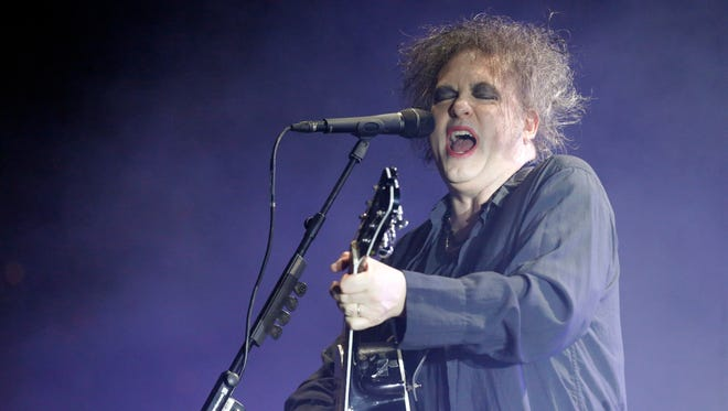 The Cure lead singer and songwriter Robert Smith performs one of the groups many hits Tuesday night at the Don Haskins Center.